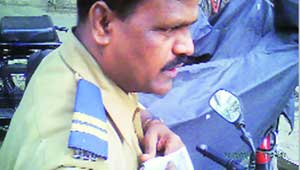 policeman taking bribe